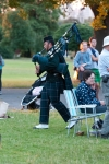 The piper plays amidst the audience